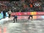 In a time of 1:08.89, Shani Davis of USA, crosses the finish line to make Olympic history, winning the 1000m title and becoming the first Afro-American to receive an individual gold medal in the Winter Olympics. His compatriot, Joey Cheek, takes the silver home finishing only .27 seconds after the winning time, while Erben Wennermars of Netherlands claims the bronze medal. Speed Skating Men\'s 1000m Final - Turin 2006 Winter Olympics - Shani Davis (USA), Joey Cheek (USA), Erben Wennemars…