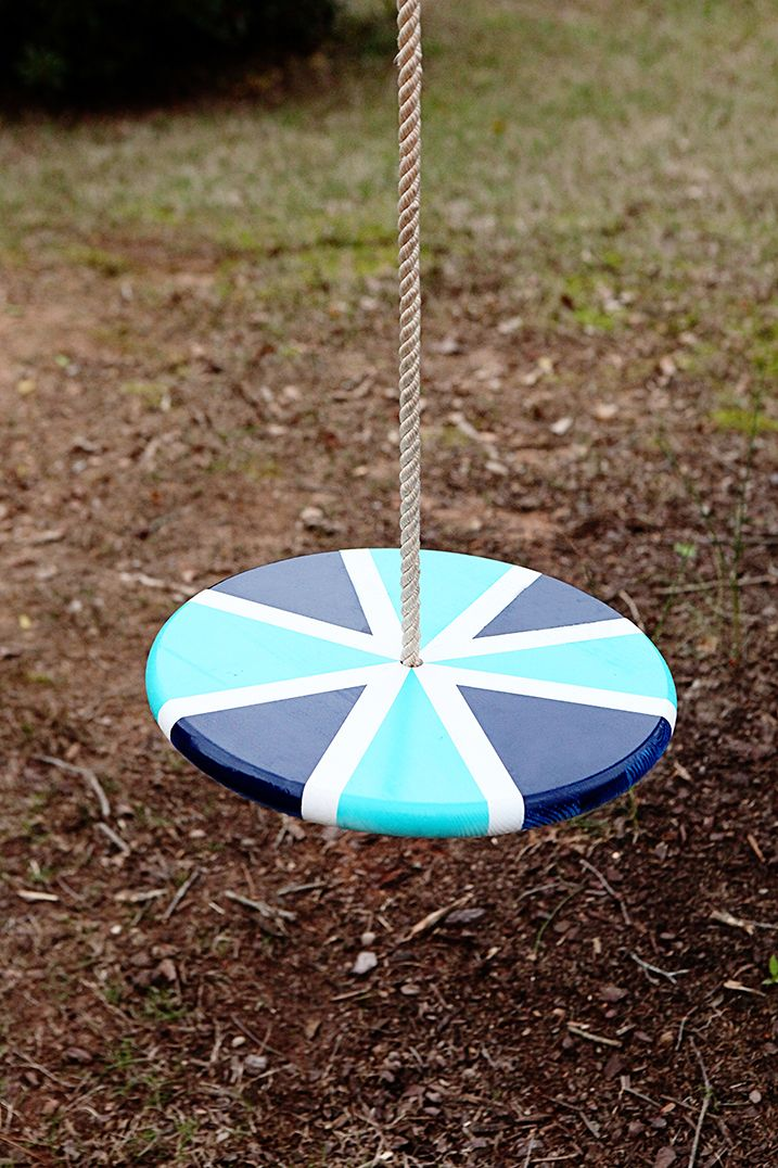 Flat round wooden swing painted blue and white with a rope for Round porch swing