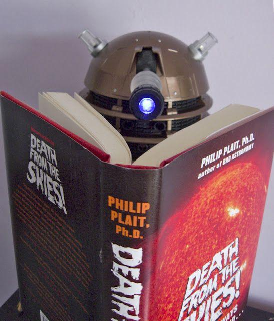 An unidentified Dalek reads.
