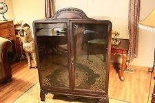 """Antique 50"""" Tall Wooden Display Cabinet with Glass Doors & Decorative Top"""