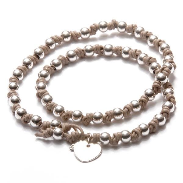 Romantische ketting met zilveren hart. Staat symbool voor de liefde voor je man.