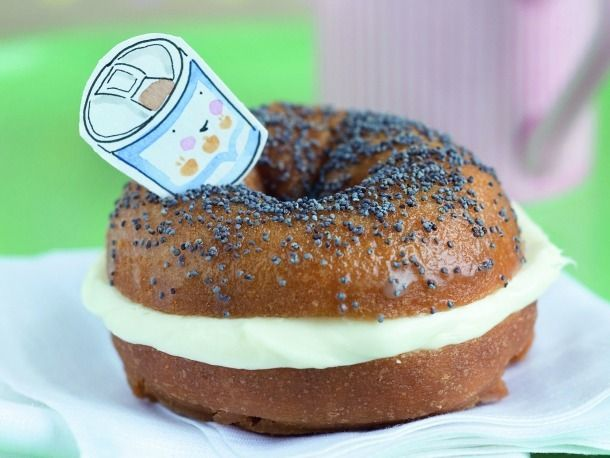 Trompe L'oeil Bagels With Cream Cheese. What looks like an innocent enough poppyseed bagel with cream cheese is in fact a clever cover for a doughnut sandwich with buttercream frosting. We won't tell if you don't.