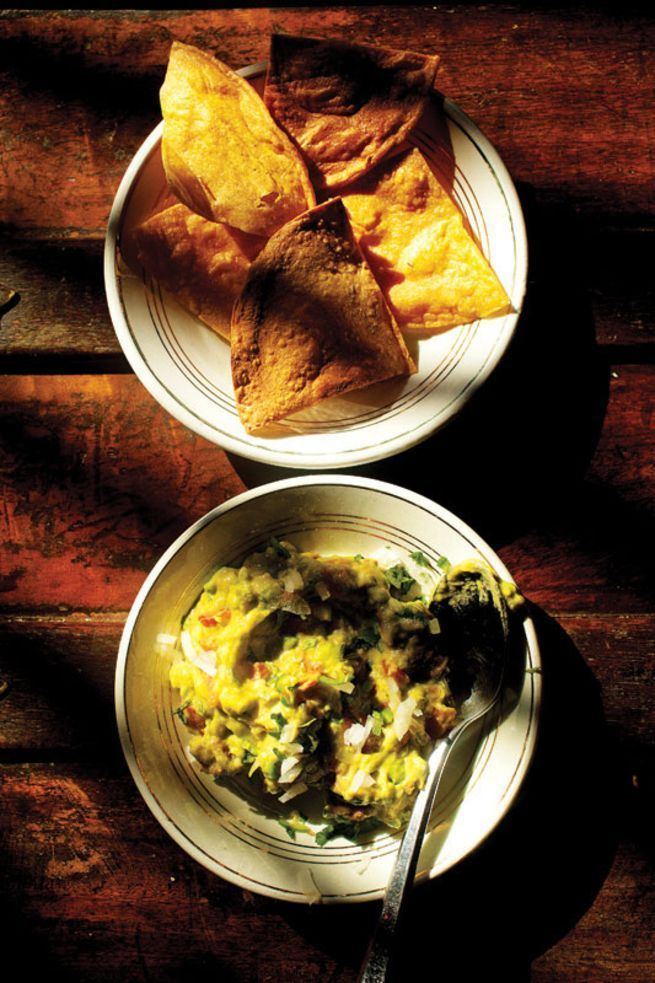 Angela Tovar Morales, a cook at La Casa Dragones—the home of Casa Dragones Tequila in San Miguel de Allende, Mexico—gave us the recipe for her classic guacamole with fresh tortilla chips. For the best results, she suggests making it in a molcajete, or mortar and pestle.