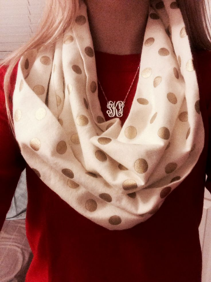 Cream infinity scarf with gold polka-dots.
