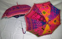 June 1, 2012 Handmade Indian garden umbrella for patio table - from Wisteria catalog - sticks in the ground