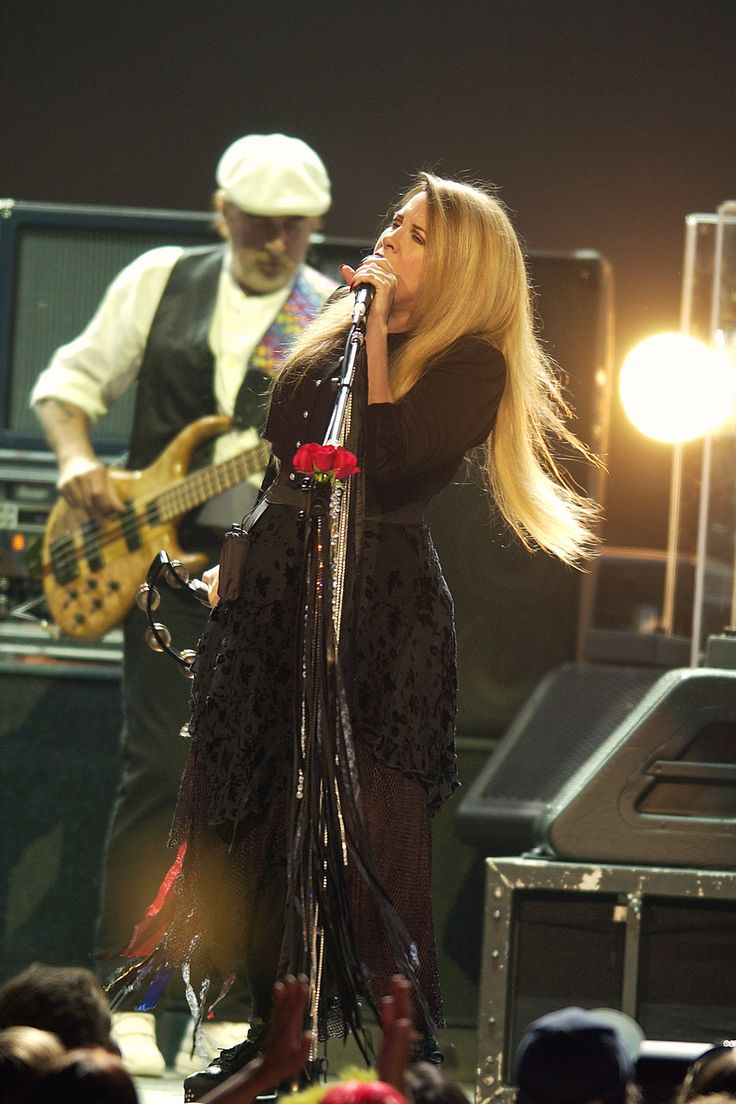Stevie ~ ☆♥❤♥☆ ~ with John McVie behind her when they performed at the 'Say You Will' tour with the other members of Fleetwood Mac in 2003 - 2004 ~ https://en.wikipedia.org/wiki/Say_You_Will_Tour