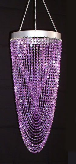 This luminous chandelier has strands of purple diamond-cut crystals that are designed in a swooping twisted fashion to refract the light. The diameter is 9 inches and the length is 21 inches. *Ligh...