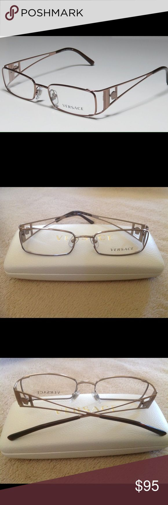 NWOT Women Versace Eyeglasses w/ Case Authentic These ladies eyeglasses are new. They are a metal frame in mocha brown or bronze color. Versace Accessories Glasses