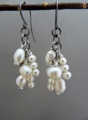 Gorgeous natural pearl, dangle earrings wrapped with non tarnishing silver plated wire. Hung on gunmetal gray jump rings and handmade gunmetal ear wires. MEMBER - GHdesigns by tbrad