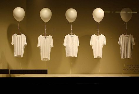Cool simplistic t-shirt window display                                                                                                                                                     More