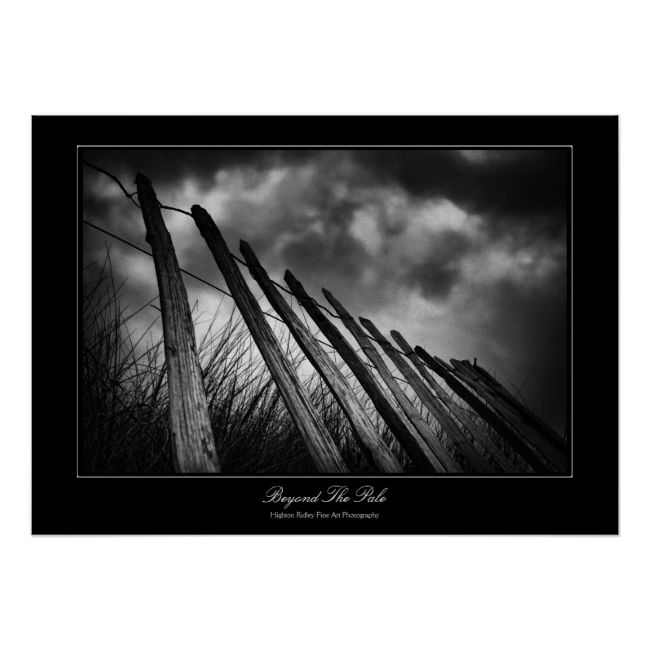 "Beyond The Pale, A fine art photography poster in our Dreamy Moments series. The picture is of a fence at the side of sand dunes at Bantham Beach, Devon. The title has nothing to do with buckets :) An old word for fence was based on the word ""pale"", meaning pointed wooden sticks (think ""impale""). These fences marked the (defensive) boundary of a village or group of houses, so being ""beyond the pale meant...read more"