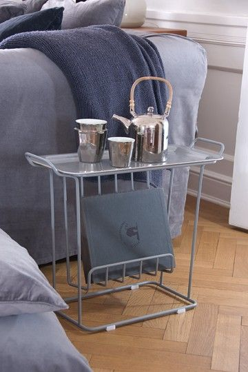 Minnie Mae Paper is a side table to have next to the couch or bed. The table consists of a frame of metal wire with a loose tray in birch wood from Swedish Åry Form. Minnie Mae Paper is a versatile table where you can store your magazines and use as a side table or bedside table.