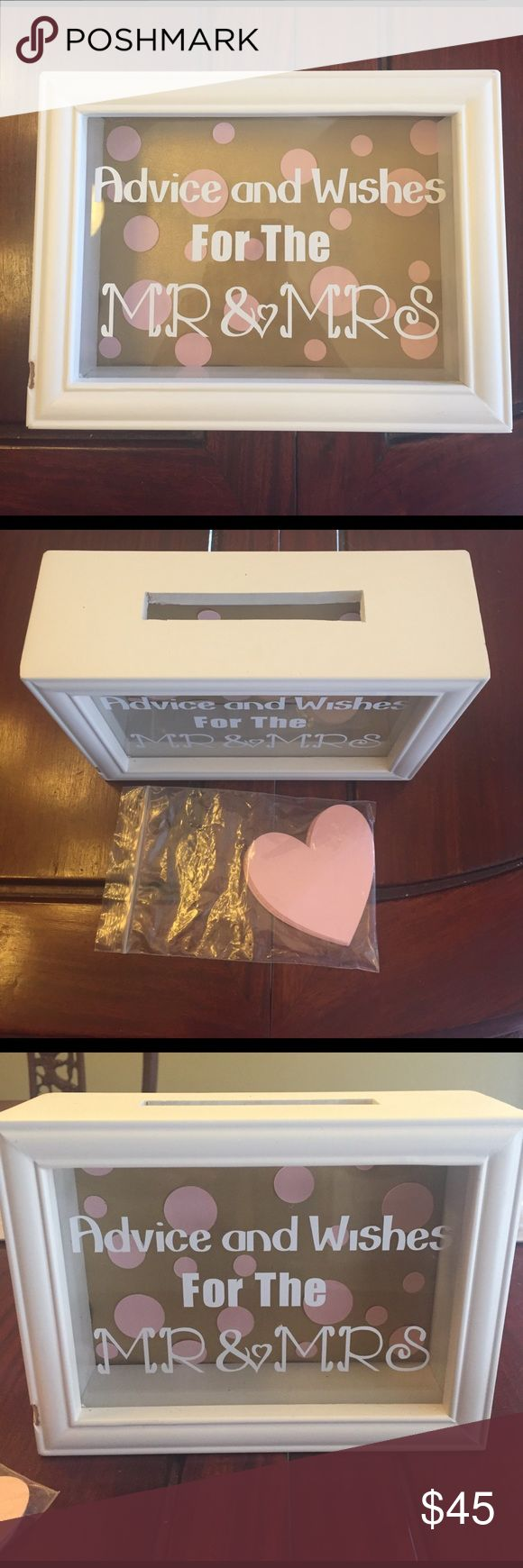"Mr & Mrs advice box Only used once for my bridal shower! White shadow box hand made into a cute advice box. Background is gold with pink polka dots, and the window has white wording ""Advice and Wishes for the Mr & Mrs"". Comes with pink heart cut outs for guests to write advice on and insert into the slot. Other"