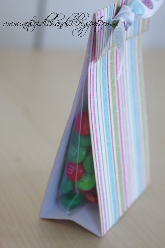 Choose scrapbook paper... cut attach baggie inside fold top hole punch and tie a coordinating ribbon. Love this!