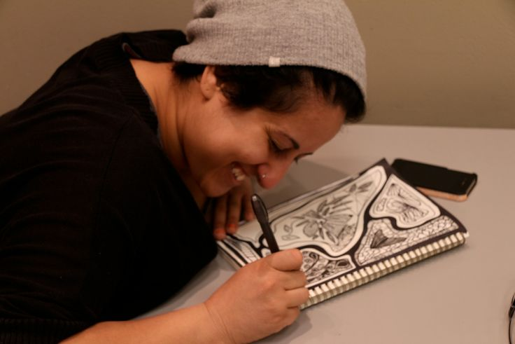 Huda creating one of her beautifully detailed illustrations