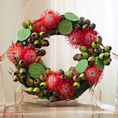 green eucalyptus pods and red pincushions (leucospermum)- this looks very Aussie, despite not being so