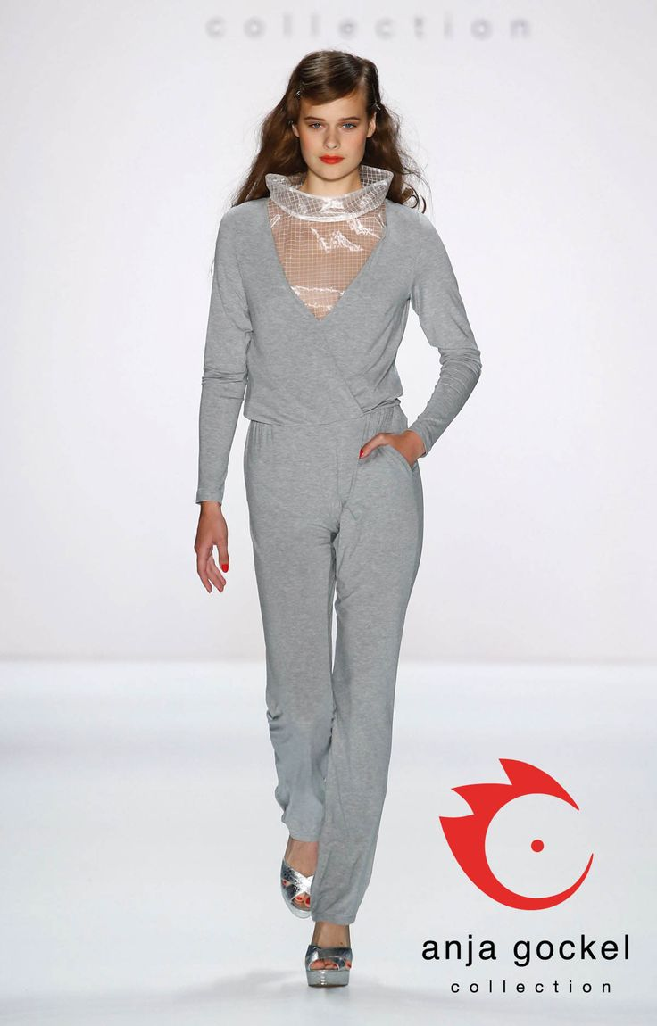 Opposites attract. A gorgeous interplay of styles and fabrics. Grey jumpsuit made from jersey with a plunging v-neck teamed with a transparent ripstop sweater defined by its oversized banded collar.