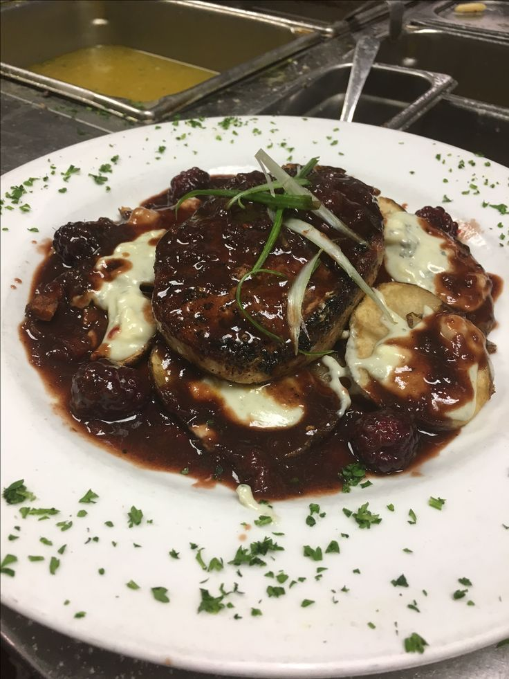We had the Monday blues until we saw this photo of this stunning 8 ounce pan roasted pork filet topped off with gorgonzola cheese, on a bed of au gratin style potatoes finished with a blackberry wine sauce. This is one of the many specials that Chef Bill creates nightly at The Hawthorne Inn in Labadie, MO where you can also find an award winning coconut cream pie #suchatreat! Be sure to make a reservation & enjoy the drive to this delicious restaurant #bestrestaurantsinstl