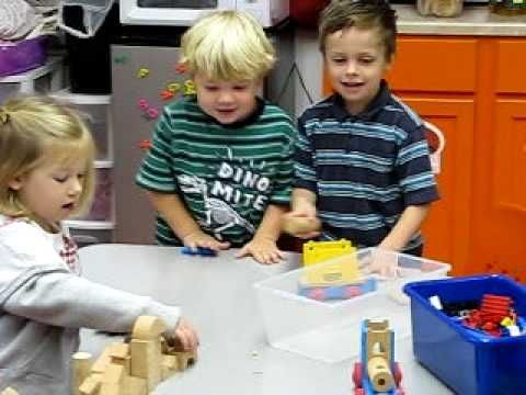 This youtube clip shows two boys and one girl playing with toys.  They are old enough to play together.  The children look like they are having fun.  They are getting along well. They are also communicating verbally.