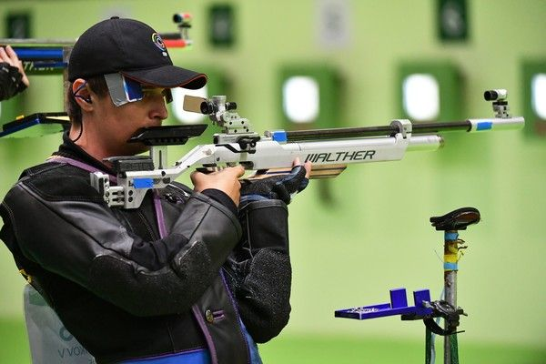 Russia's Vladimir Maslennikov  competes during the 10m Air Rifle Men's at the Olympic Shooting Centre in Rio de Janeiro on August 8, 2016, during the Rio 2016 Olympic Games. / AFP / PASCAL GUYOT