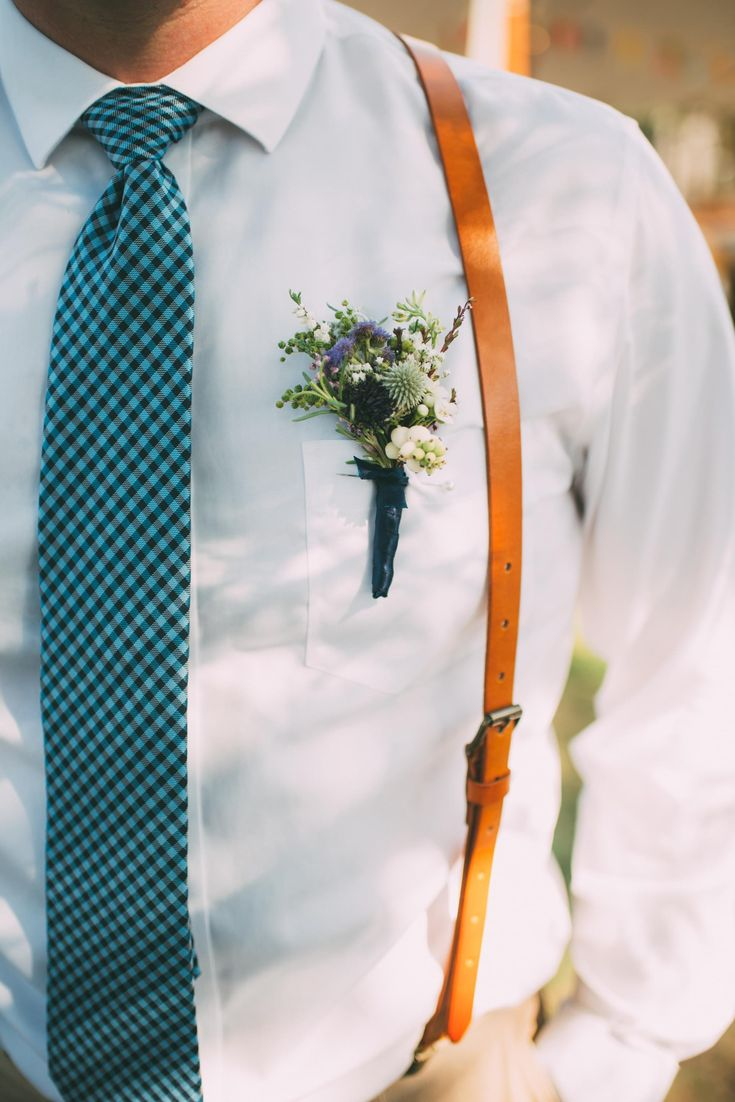 Leather suspenders, checked tie, blue thistle & snowberries boutonniere, casual groom style // Cait Bourgault Photography