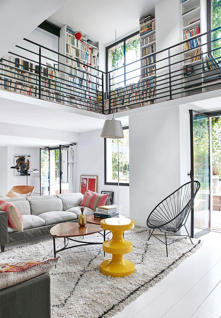 Loft like living room with bookshelves in a villa in France