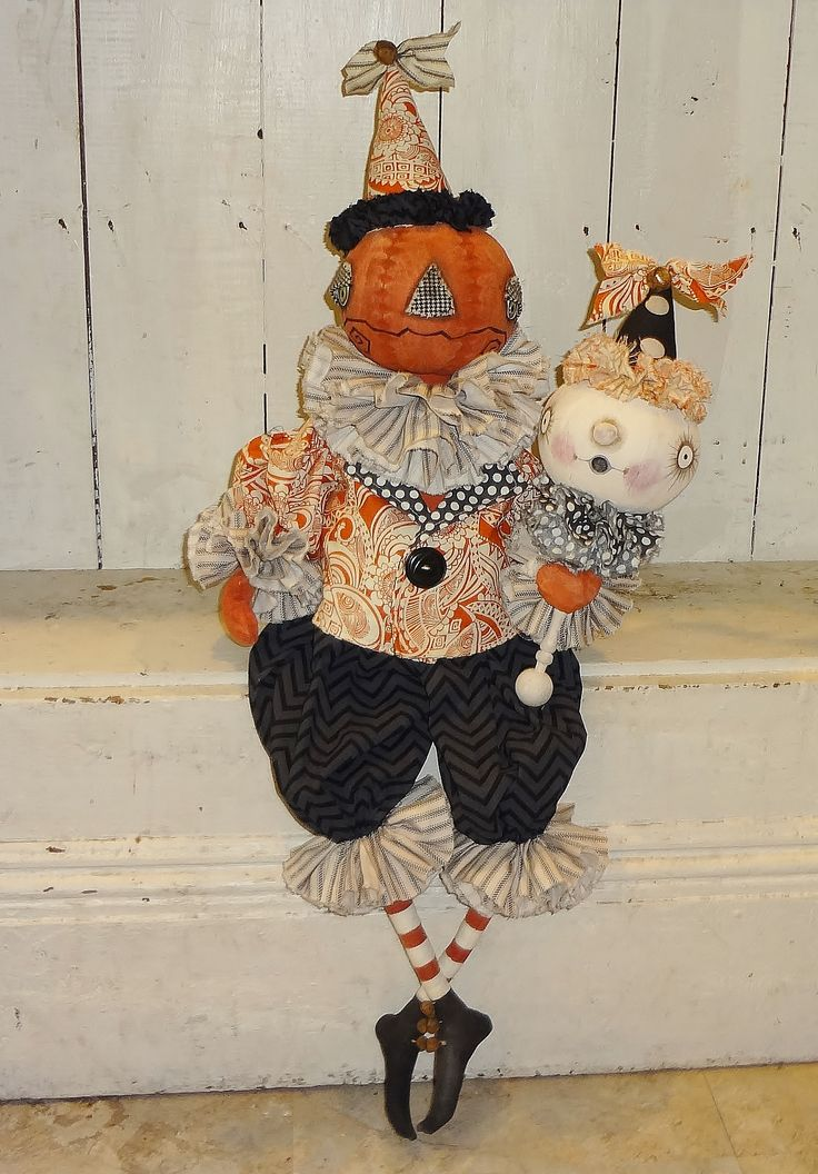 Halloween Jack O Lantern doll with ghost rattle.   The Pixie's Thimble by Cindy Conrad