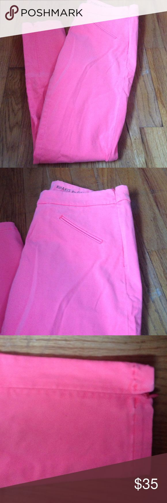 Khakis by gap Neon pink pants. Super skinny. They are a warmer color as opposed to the cool pink that the picture is showing. It zips on the side. And it has zippers by the ankles. Soft texture pants GAP Pants Skinny
