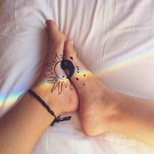 Wonderful looking Yin Yang tattoo on the feet. When combined they form the harmonious Yin Yang.