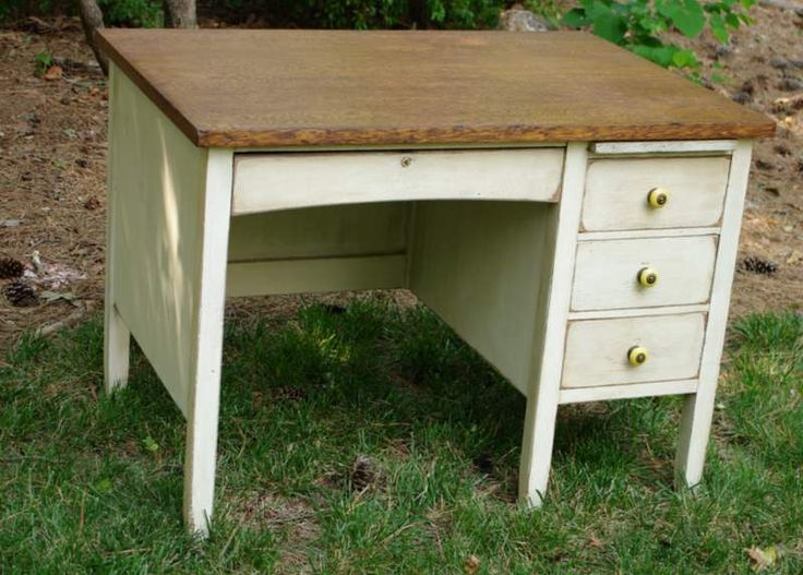 The desk's base and drawer exteriors were painted a custom mix of Annie Sloan's Country Grey and Pure White and waxed with clear wax and dark wax to hightlight the wood's character.