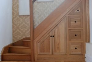Cabinet and drawers under stairs. by esmeralda