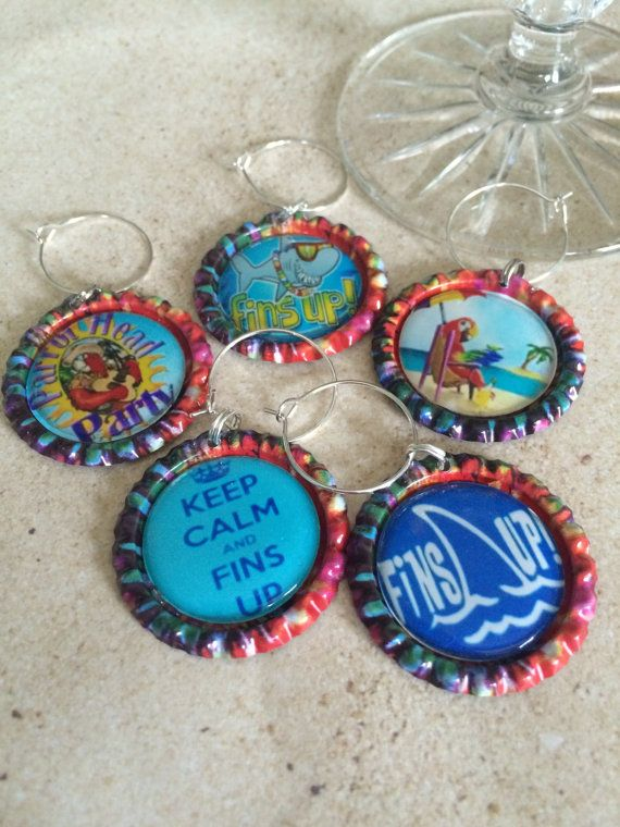 Check out this item in my Etsy shop https://www.etsy.com/listing/271413173/jimmy-buffett-wine-charms-margarita