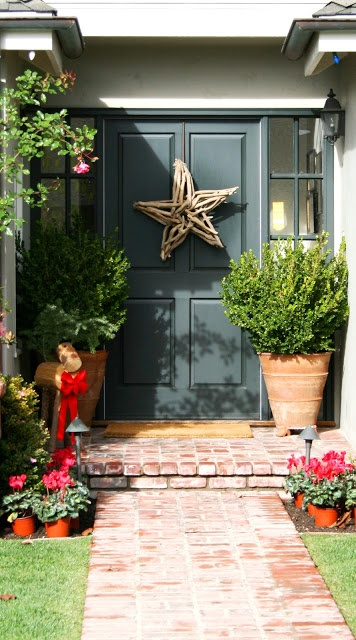 Make a driftwood star for the front door.   http://www.completely-coastal.com/2012/12/diy-christams-holiday-star-made-with-drift-wood-sticks.html