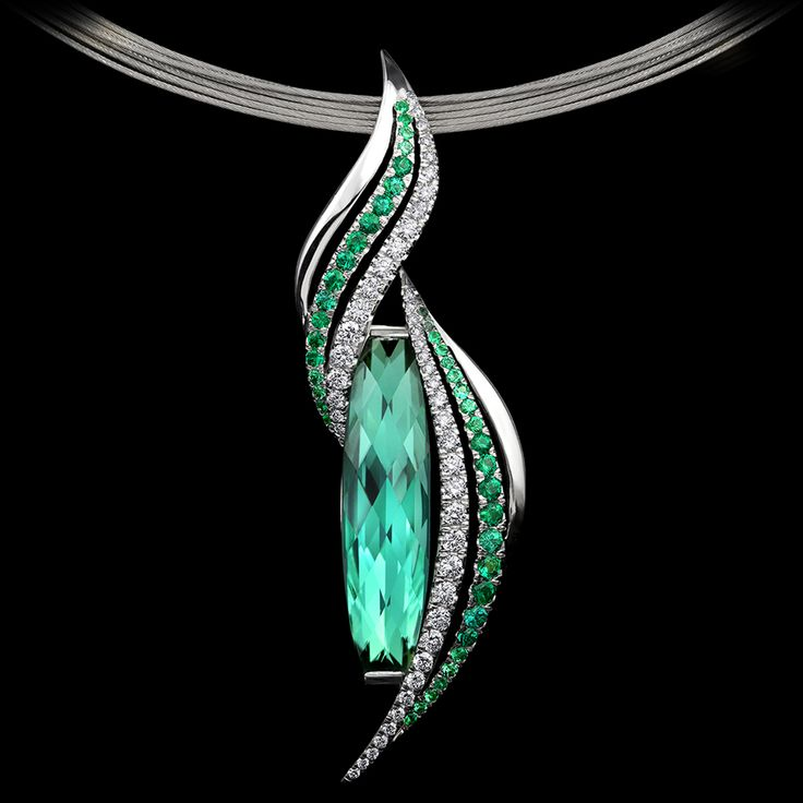 Emerald Flame Pendant by Adam Neeley.  Emerald Flame Pendant features a tourmaline cut by Stephen Avery, accented with pavé set emeralds and diamonds in white gold.