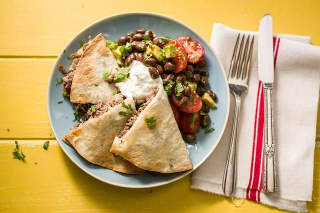 We're sautéing beef with onions and oregano to give these quesadillas extra flavor. Instead of cooking them one-byone in a pan, we've come up with a technique to get crispy, gooey quesadillas in the oven. Black bean-avocado salsa is a hearty and delicious twist on traditional salsa.