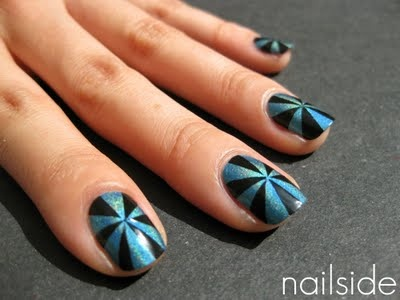 Pinwheel! 5 or 6 pieces of tape cut into triangles and placed with the tips in the center of the nail. Try it with many colors on one nail