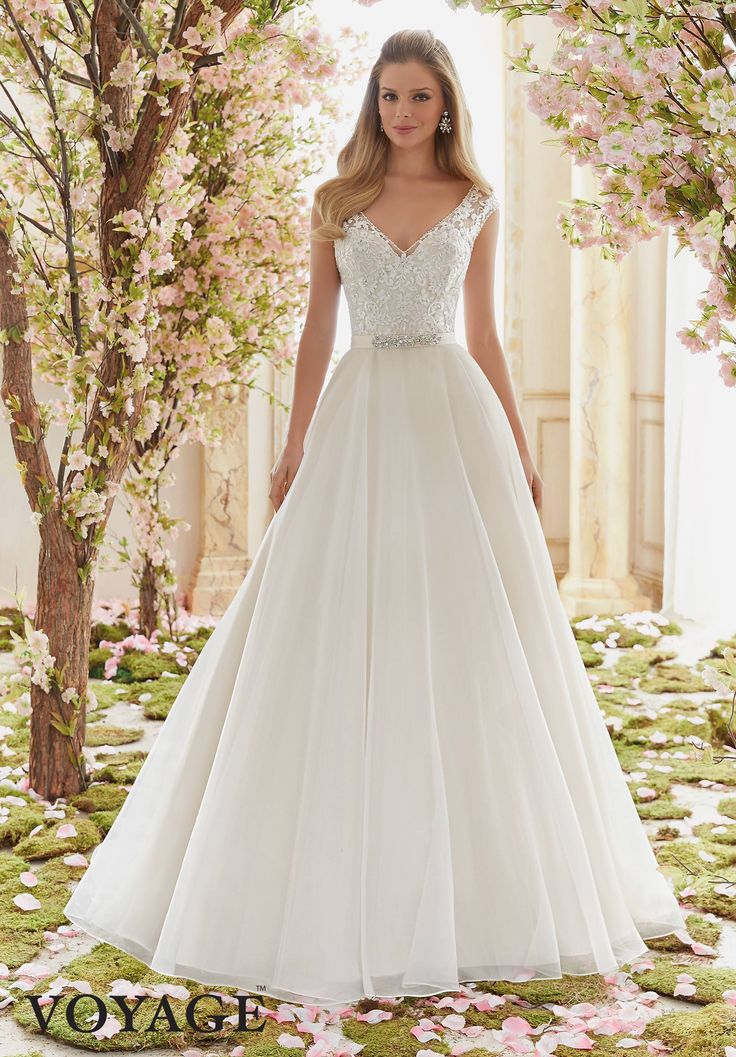 Morilee Voyage collection. Style number 6836. Elegant sweetheart strapless lace bodice. A-line wedding dress with crystal belt and tulle train.