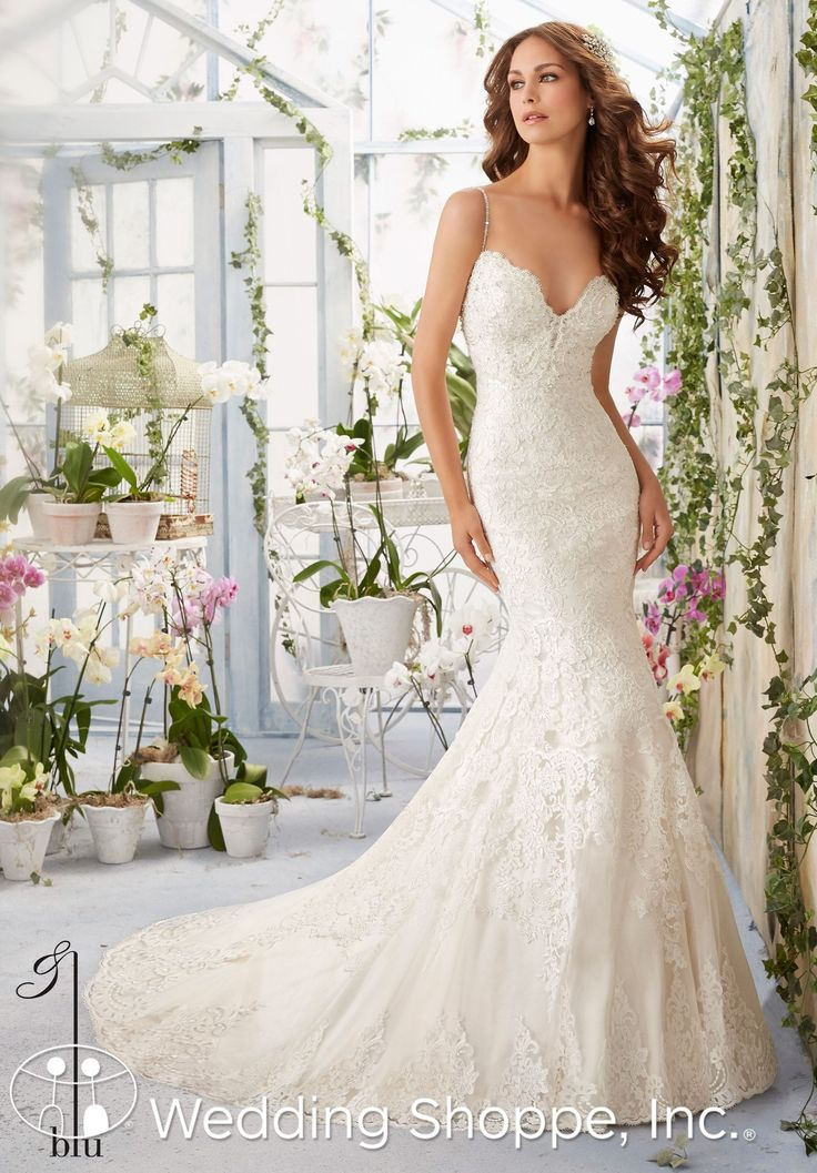 Trendy A beautiful lace wedding dress with beaded spaghetti straps and deep sweetheart neckline