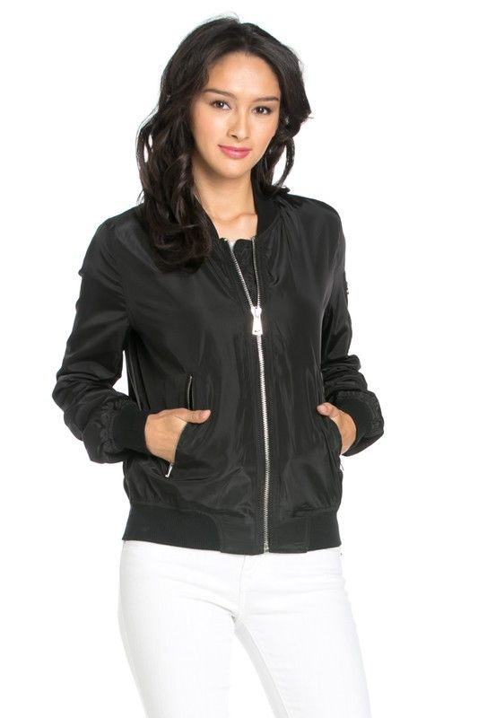 Our lightweight black bomber jacket features a stand collar, front-zipper closure and slanted front zipper pockets. Long sleeves with a zippered pocket on one of the shoulders. Ribbed detailing on the
