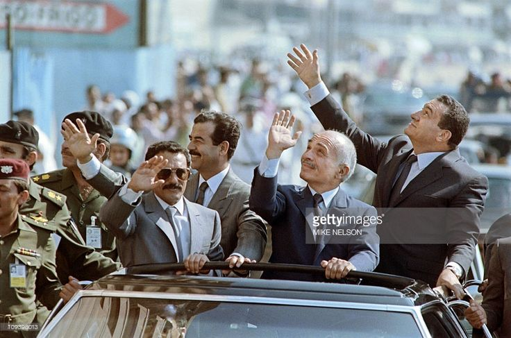 North Yemeni President Ali Abdullah Saleh, Iraqi President Saddam Hussein, Jordanian King Hussein and Egyptian President Hosni Mubarak, wave to the crowd, on June 15, 1989 during a motorcade rally prior to the opening of the Arab Cooperation Council in Alexandria, Egypt.