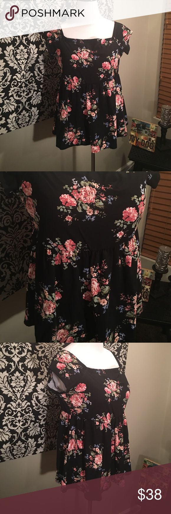 """Torrid black floral off the shoulder babydoll top """"Give them the bold shoulder; this babydoll top makes it easy. The black knit off shoulder design is a little bit retro, a whole lot of garden-friendly with a multi-color floral print. The babydoll cut is totally flattering, and keeps you in a swing state. Size 1 measures 29 1/2"""" from shoulder: Rayon/polyester/spandex."""" New with tags, size 1X. torrid Tops"""