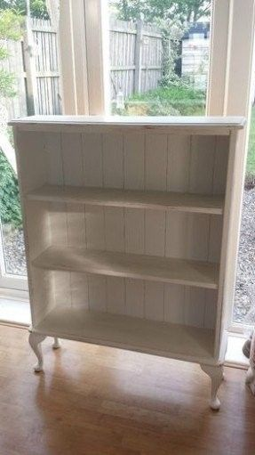 Simply replace backs of a bookcase with beadboard, add legs