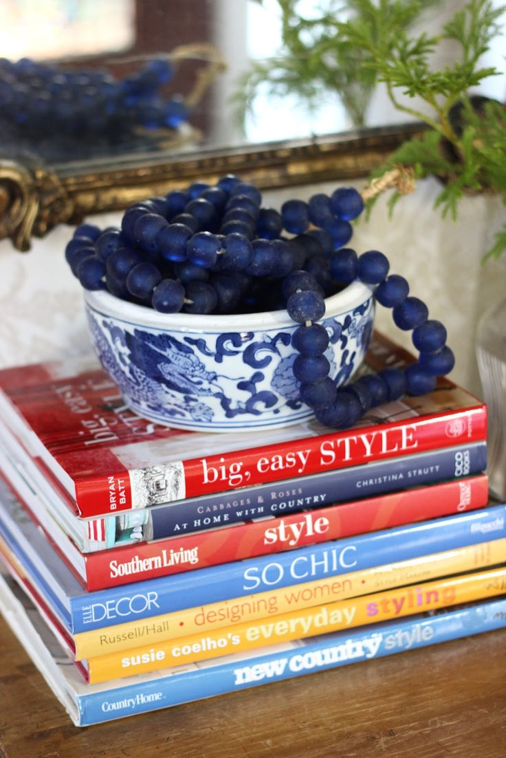 simple styling with coffee table books, beads and bowl via @sherry711