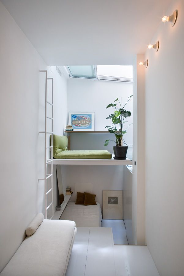 100m3 is a Madrid apartment, created by studio MYCC. Minimal & narrow at only 21 sq. m. Designers explored vertical space and built several levels. All functional zones are connected and open to view, even the bathroom is within sight.