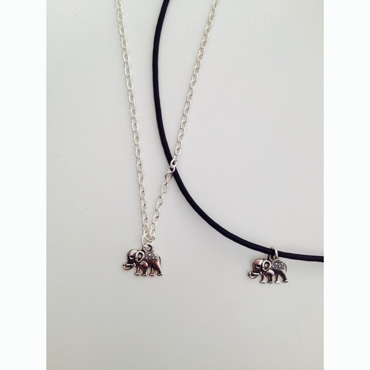 "Cute little elephant charm on a black leather cord to a length of your choice or on an 18"" silver chain. Treat yourself to matching earrings to complete the set!"