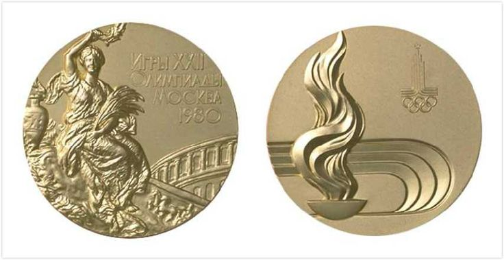 Moscow, Soviet Union 1980 Summer Olympics Medals.  The idea of featuring the host city logo on the reverse continues, above a stylized representation of a stadium and Olympic flame and cauldron.