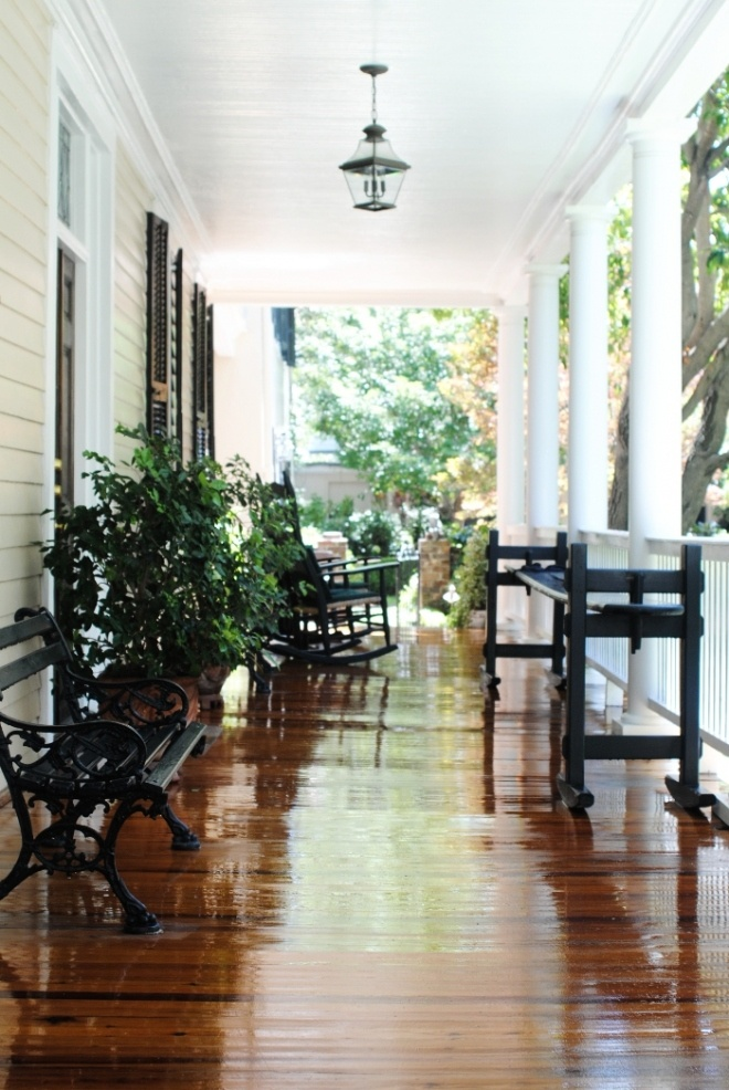 South Carolina front porch ~ gorgeous floor!!   This has it all--a Charleston Bench, Joggling Board and Rockers.
