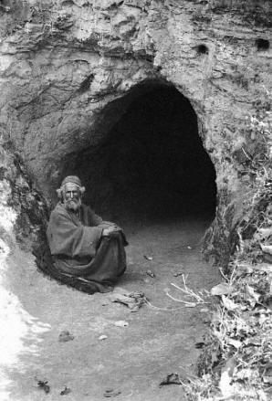 Fakir in front of his self-made tomb