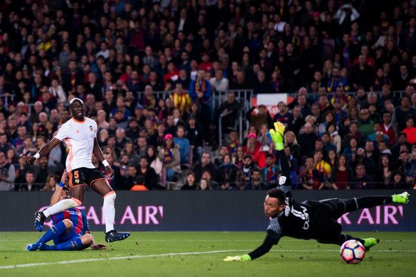 Luis Suarez of FC Barcelona shoots on goal and scores his team's first goal during the La Liga match between FC Barcelona and Valencia CF at Camp Nou stadium on March 19, 2017 in Barcelona, Catalonia.