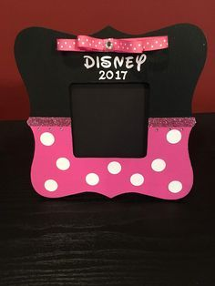 A personal favorite from my Etsy shop https://www.etsy.com/listing/512194178/pink-and-black-disney-picture-frame